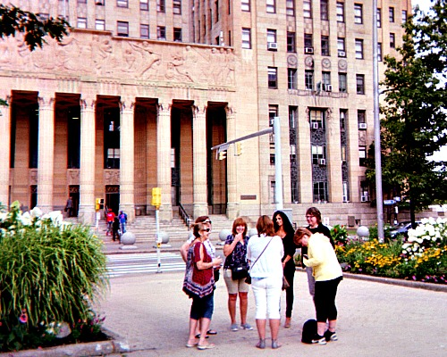 Teachers in front of City Hall in Buffalo, NY using apps for mobile phones.
