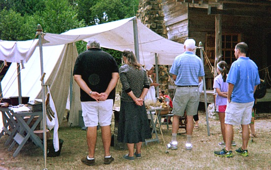 Top recreation adult entertainment and a senior watching a colonial demonstration.