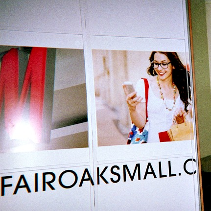 Adult personal page pictures a woman at a shopping mall holding a mobile phone.