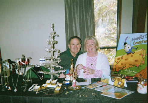 Education online resources and Susan Furst's jewelery display at a a craft show.