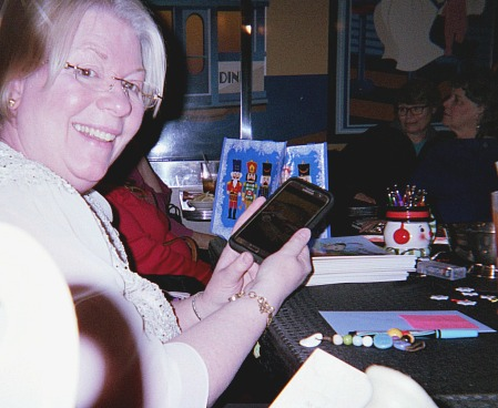 Education online resources showing Susan Furst holding a mobile phone.