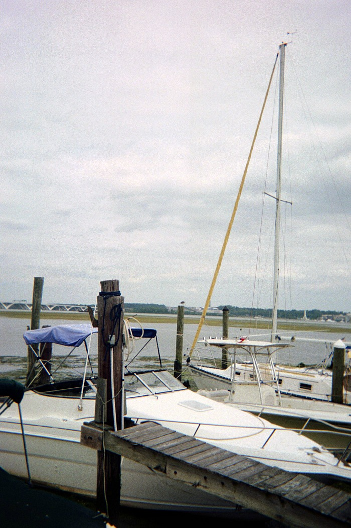 Tall mast on a boat in the water.