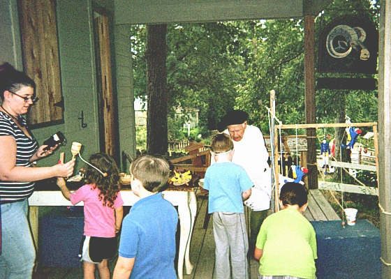 Toymaker at a colonial demonstration.