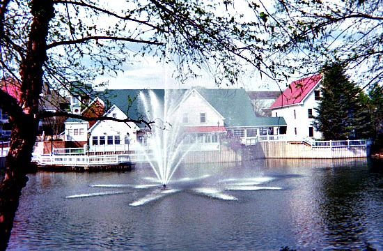 Water fountain spouting from a pond in front of a restaurant in Tackett's Mill.