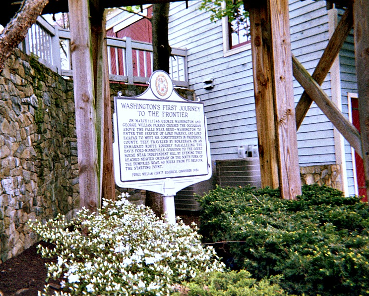 Historical marker in front of historic site.