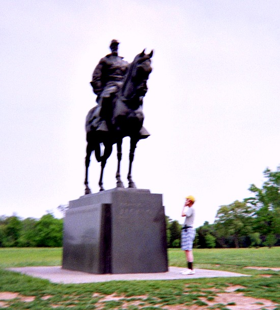 Cell phone prices, Civil War statue and my husband talking on new cell phone.